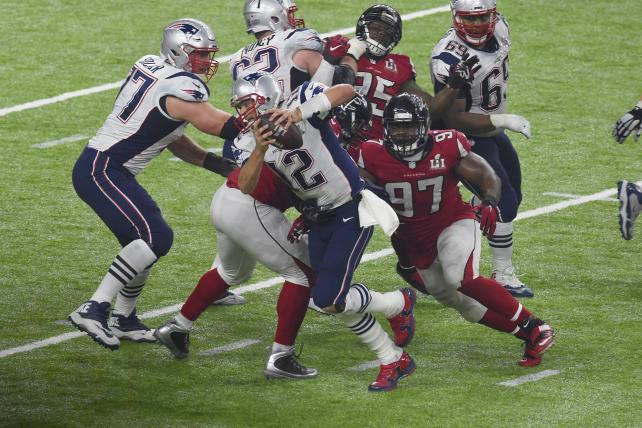 The Atlanta Falcons' Grady Jarrett pursues the New England Patriots' Tom Brady during Super Bowl 51 at NRG Stadium on Feb. 5, a game carried by Fox.