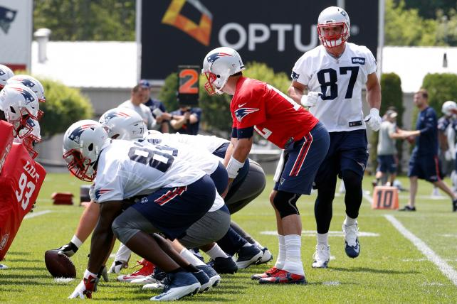 Patriots tight end Rob Gronkowski goes in motion as Tom Brady calls the signals during practice earlier this month.