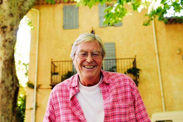 Writer Peter Mayle in the town of Cucuron, Provence, France.