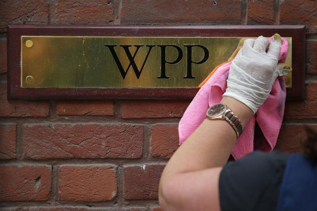 A company plaque is cleaned outside the offices of British advertising giant WPP in London on August 23, 2017.