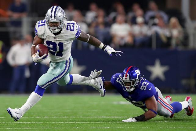 Ezekiel Elliott of the Dallas Cowboys carries the ball against B.J. Goodson of the Giants in the second half at AT&T Stadium on Sept. 10.