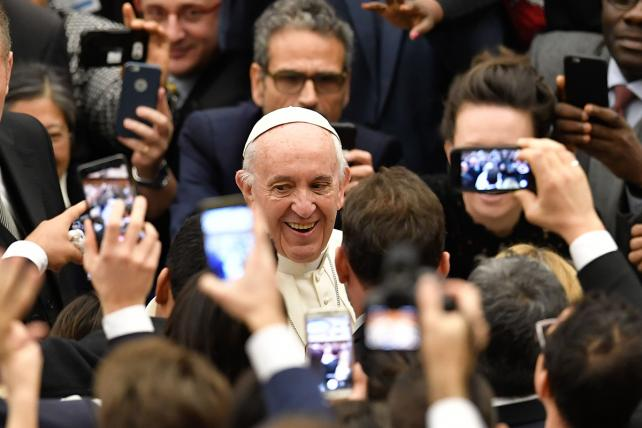 Pope Francis smiles as he arrives for his weekly general audience at the Paul VI audience hall on December 13, 2017 at the Vatican.