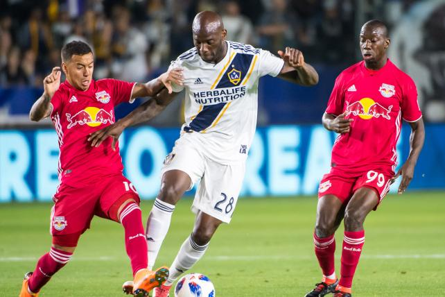 Michael Ciani #28 of Los Angeles Galaxy battles Alejandro Romero Gamarra #10 of New York Red Bulls during the Los Angeles Galaxy's MLS match against New York Red Bulls at the StubHub Center on April 28, 2018 in Carson, California