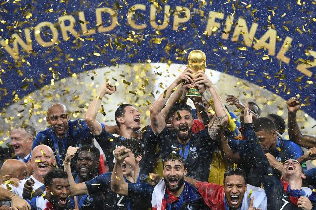 France's players hold their World Cup trophy as they celebrate their win during the trophy ceremony at the end of the Russia 2018 World Cup final football match between France and Croatia at the Luzhniki Stadium in Moscow on July 15, 2018.