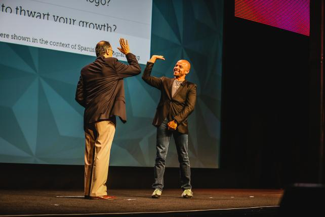ANA's Bob Liodice exchanges a high-five with Jonathan Mildenhall, CMO of Airbnb, at the 2015 ANA Masters of Marketing