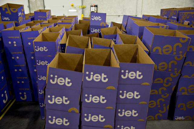 Shipping boxes are readied for packing at a Jet.com facility.