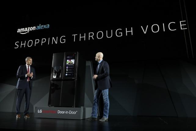 LG executives demonstrate new product capabilities involving Amazon's Alexa.