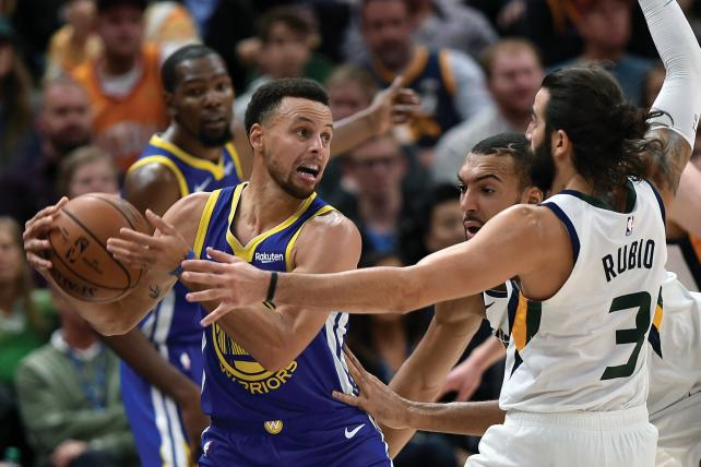 The Golden State Warriors' Stephen Curry fights off Ricky Rubio and Rudy Gobert of the Utah Jazz in an NBA game in October.