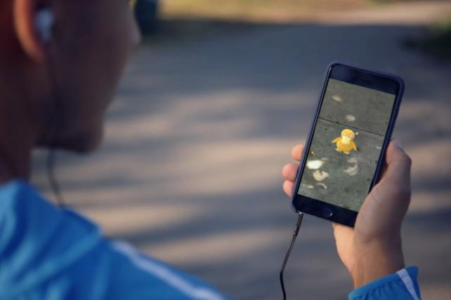 A scene from the trailer for Pokémon Go -- now being enacted on sidewalks around the country.