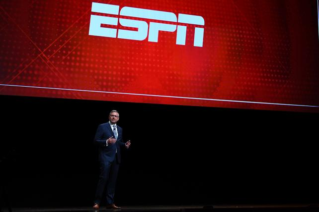 Eric Johnson, ESPN's executive VP of global advertising revenue and sales operations, during this year's ESPN upfront presentation to advertisers.