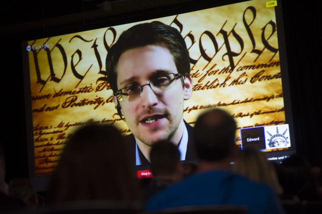 Edward Snowden, the former National Security Agency contractor, speaks on screen during a virtual conversation at South By Southwest Interactive in Austin, Texas, in 2014.