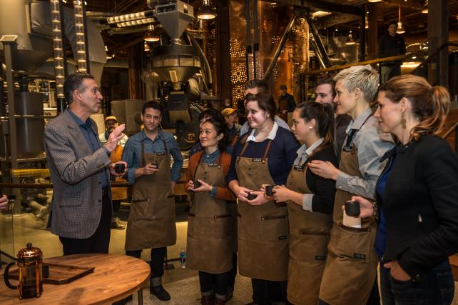 Howard Schultz addresses employees at the opening of the Starbucks Reserve Roastery in Seattle.