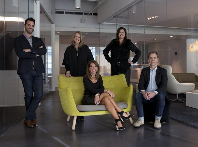 TM Advertising's Jeff Kempf, chief digital officer; Lisa Bennett, chief creative officer; CEO Becca Weigman (seated); Kim Moss, chief media officer; and Tyler Beck, chief strategy officer.