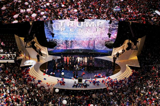 Republican presidential candidate Donald Trump and Republican his runningmate Mike Pence stand with their families at the end of the Republican National Convention on July 21, 2016 at the Quicken Loans Arena in Cleveland.