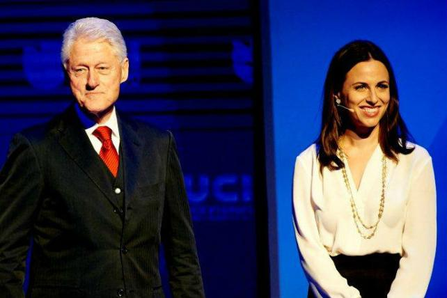 Bill Clinton with Alicia Menendez, a host on Fusion, the joint venture between Univision and Disney.