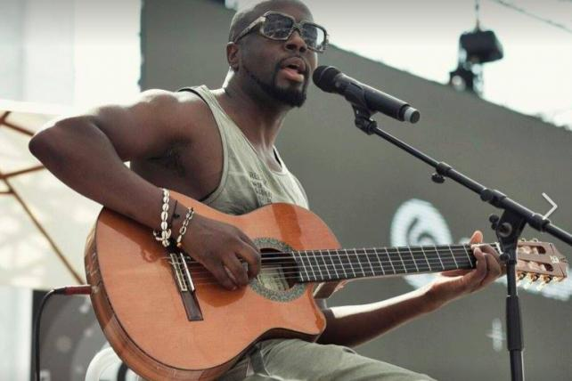 Wyclef Jean performs at the end of his Cannes panel.