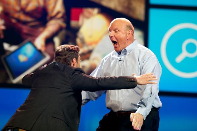 Steve Ballmer, then CEO at Microsoft, right, enthusiastically greets Ryan Seacrest at the 2012 International Consumer Electronics Show in Las Vegas.