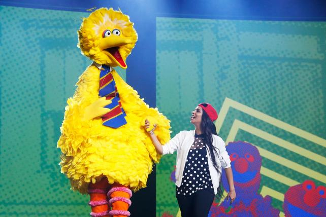Big Bird and YouTuber Lilly Singh pitch onstage during YouTube Brandcast presented by Google on May 5 in New York.