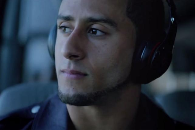 Colin Kaepernick in a Beats by Dre Commercial.
