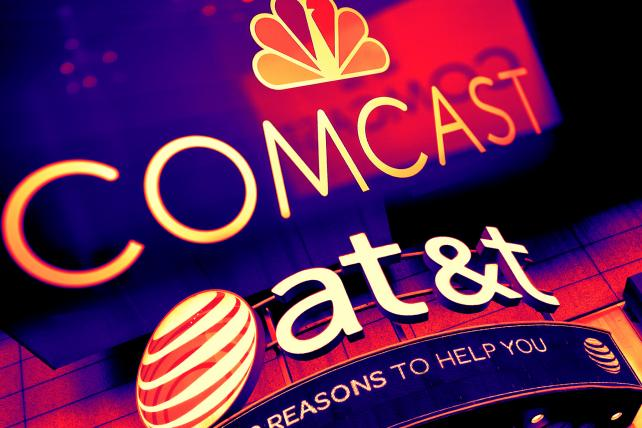 Here's what to watch when AT&T and Comcast report earnings this week