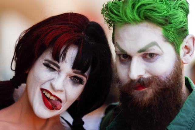 Attendees dressed as DC Comics' Harley Quinn and Joker during the Comic-Con International convention in San Diego.