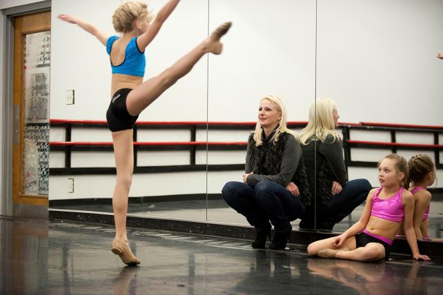 (From l.) Chloe shows her mom Christi and fellow dance Maddie her new routine on 'Dance Moms' on Lifetime, part of A&E Networks.