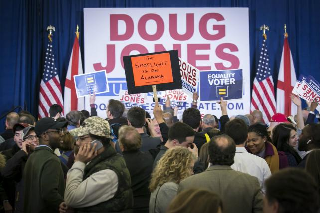 Attendees celebrate during an election night party for Senator-elect Doug Jones, a Democrat from Alabama, in Birmingham, Alabama, U.S., on Tuesday, Dec. 12, 2017.