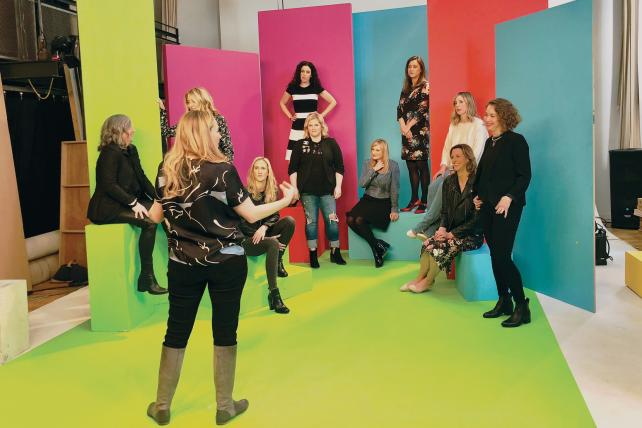 In a show of solidarity, 10 women from competing agencies posed for a rare group shot for our A-List issue. This behind-the-scenes photo, including our photographer, Robyn Twomey (back to the camera), was taken during a break.