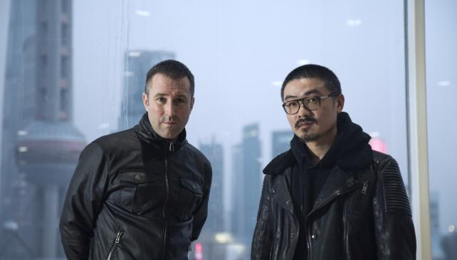 Frédéric Raillard and Feng Huang in their office overlooking the Shanghai skyline
