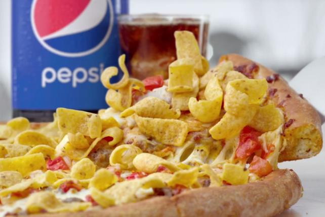 Peyton Manning Wants You to Eat a Pizza Topped With Fritos