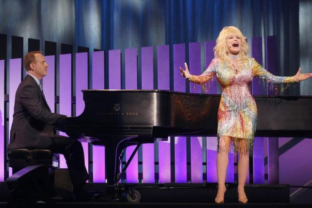 NBC Entertainment chairman Bob Greenblatt and Dolly Parton perform at NBC's upfront presentation on May 11, 2015.