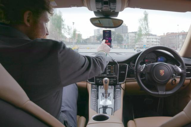 Remotely Entertaining: Watch a Mobile Phone With an AI Chip Pilot a Porsche