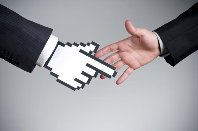 Vector cursor handshake on a real hand - Stock image