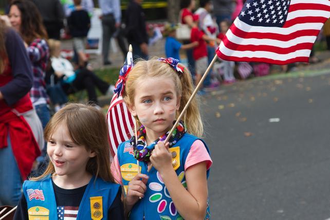 Sacramento, California USA - November 11, 2016: Young girl scouts carrying flag in Sacramento Veterans Day Parade,