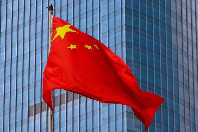 The flag of China flies over Shanghai.