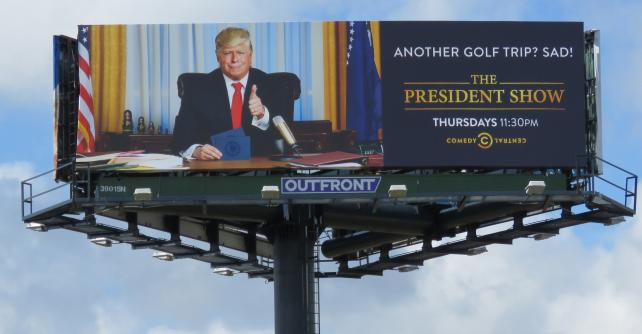 A billboard for 'The President Show' taunts the real president near Mar-a-Lago.