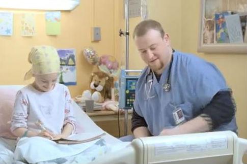 Nurse wears stethoscope in J&J ad.