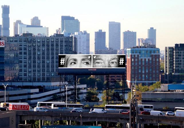 Hillary Clinton and Donald Trump peer out of a billboard from the Twitter campaign that won a Grand Prix at Cannes on Monday.