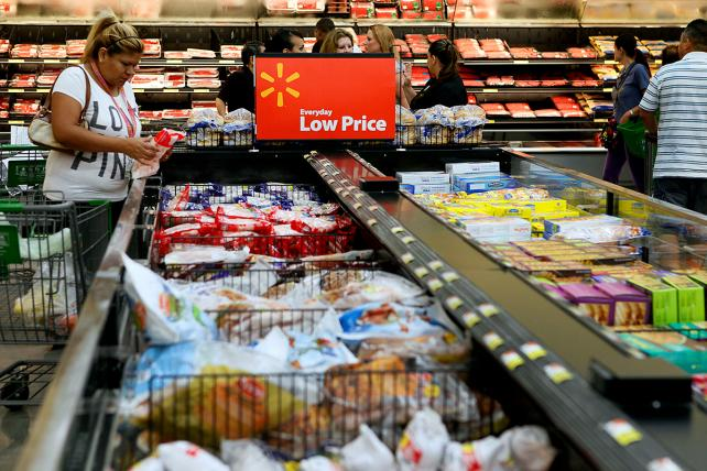 A customer shops for frozen foods at a Walmart location in Panorama City, California.