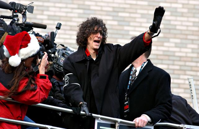 Howard Stern waves to supporters following his final broadcast on Viacom's CBS Radio network in 2005.