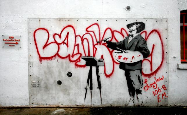 A mural by Banksy appears on a wall of a building on the Portobello road in London.