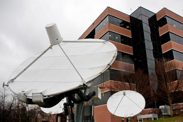 Satellite dishes stand outside the headquarters building of Sinclair Broadcast Group Inc. in Hunt Valley, Maryland, U.S., on Monday, March 15, 2010.