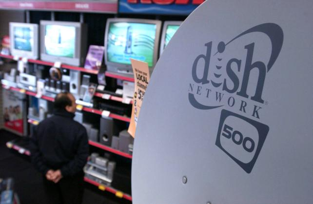 A Dish Network satellite on display near a selection of TVs in a store.