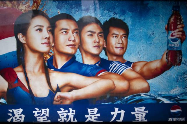 A 2013 poster uses Chinese stars to advertise PepsiCo products in Kunming in Yunnan Province, China.