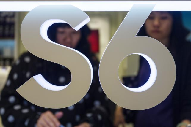 A sign for the new Samsung Galaxy S6 and Galaxy S6 Edge during an introductory event at a Samsung store in Hong Kong in April.