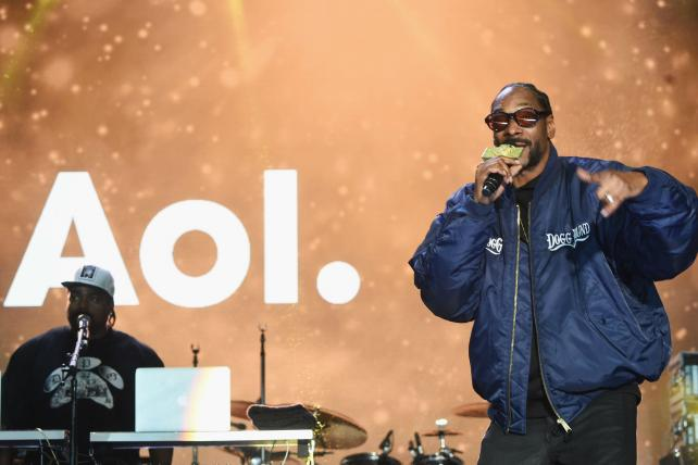 Snoop Dog performs at the AOL NewFront at New York's Seaport District on May 3, 2016. Among its original content plans, AOL picked up 'Coach Snoop,' which follows the rapper's inner city youth football league.