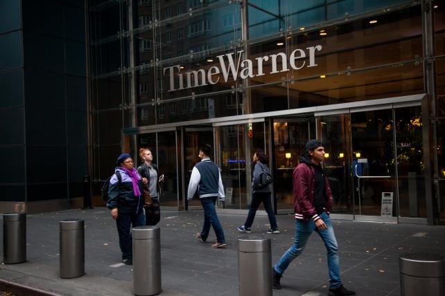 AT&T CFO Says Time-Warner Deal Timing Is Uncertain