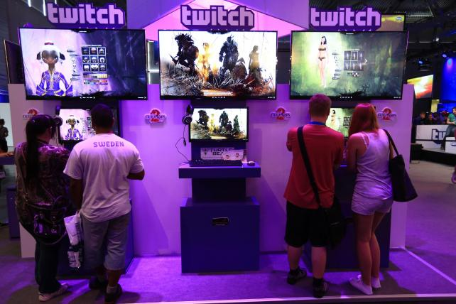 Visitors stream online computer games on the Twitch Interactive stand at the Gamescom video games trade fair in Germany in 2014.