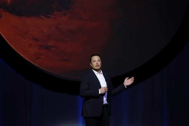 Musk signs up mystery passenger to take rocket trip around moon