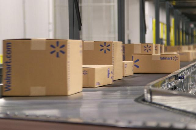 Those boxes are moving fast: Walmart e-commerce sales surged 63%.
